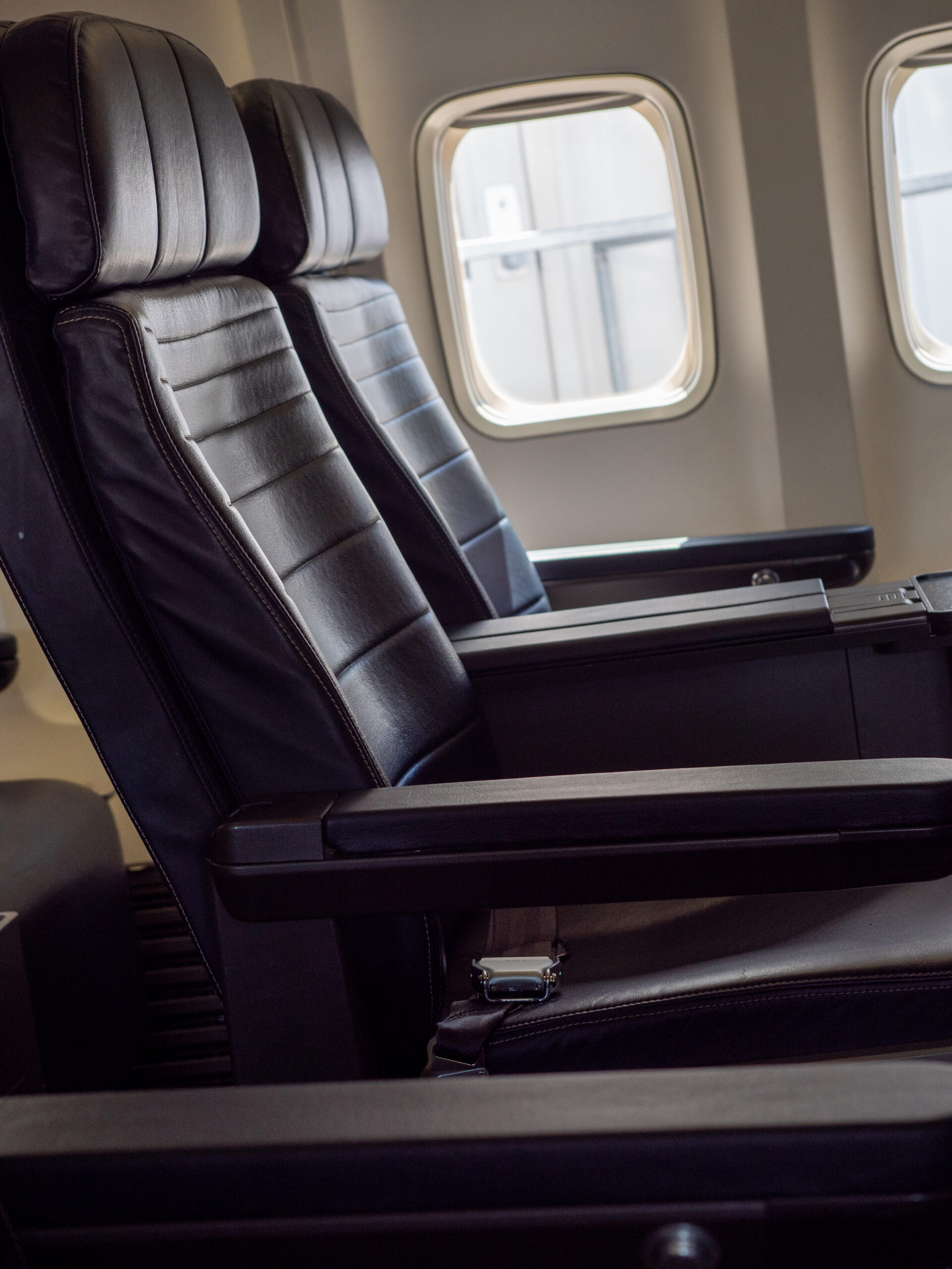 Empty first class window and aisle seat during the Coronavirus pandemic. Airline industry struggles as Americans are told to stay home to slow the spread of the disease.
