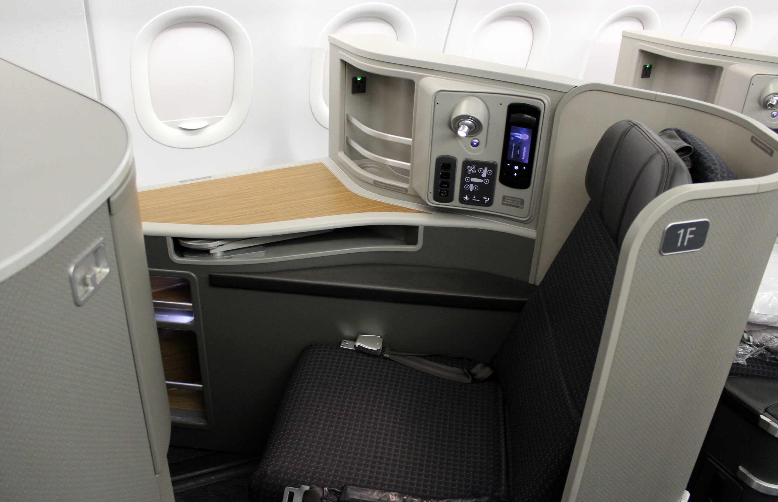 LOS ANGELES TO NEW YORK FLIGHT, USA – AUGUST 10 2015: American Airlines flight AA2 prepares to welcome first class passengers in its exclusive Flagship First Airbus A321T cabin.