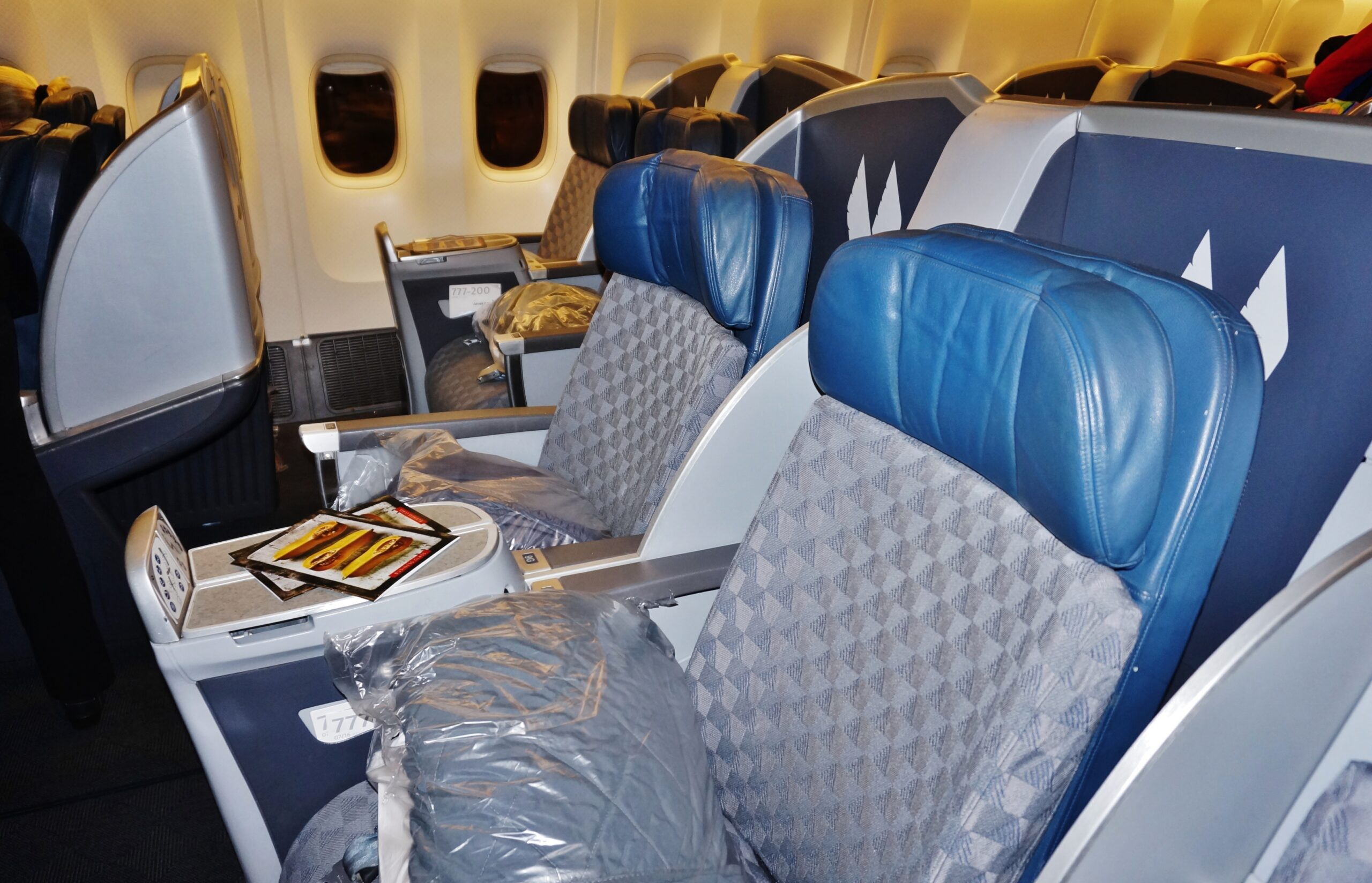 MIAMI, FL -24 JAN 2017- Inside the Business Class cabin on an American Airlines flight. AA is gradually replacing these seats with a new American Airlines Flagship experience cabin.